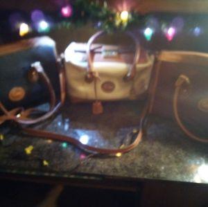 Three vintage  Dooney & Bourke handbags.